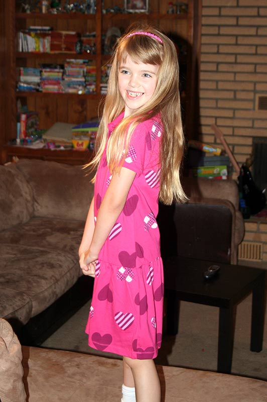 Amara modeling her dress for 1st day of school