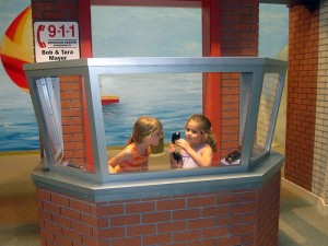 The girls played in the emergency booth.