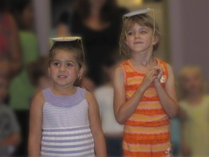 Amara and Celia had paper plate hats topped with popcorn