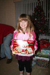 Amara and the Wilton Gingerbread house she got for Christmas