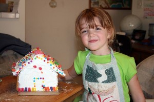 Amara shows off her finished gingerbread house