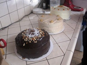 3 beautiful cakes sitting on the counter