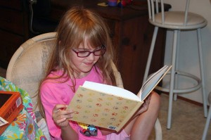 Amara reading the new book Grandma Kc made her