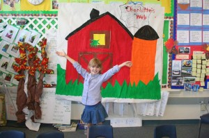 The parents helped the students paint a backdrop for the play.