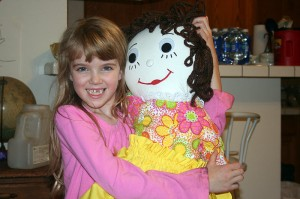 Amara is holding her new doll named Emily