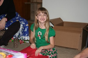 Amara opening a present on Christmas Eve