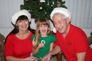 Amara and Grampy both get the giggles during the Christmas photo