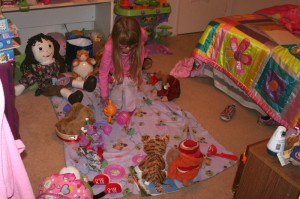 Amara gave a tea party for Emily and invited all of her stuffed friends.