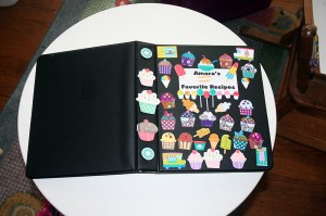 Amara's Recipe Book covered with stickers