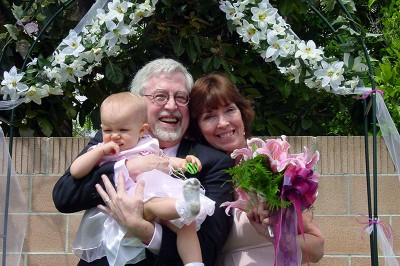 Grampy and Grandma Kc at their Wedding with Amara the Flower Girl