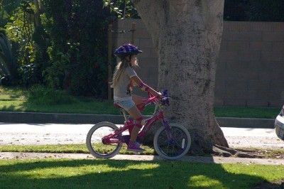 Amara riding her old bike