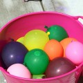 The kids filled a bunch of water balloons