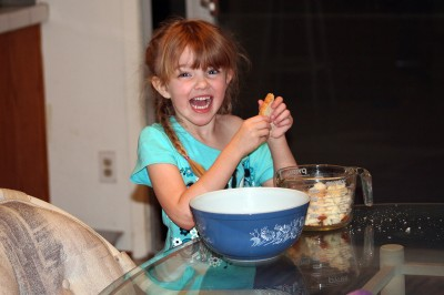 Amara grins as she tears up the bread for bread pudding