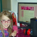 Amara looks at AmaraLand on her new computer