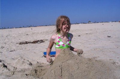 Amara buried in the sand and filled with excitement