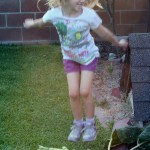 Amara Jumping on the Sunflower Stalk