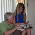 Amara reading with Grampy