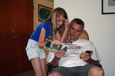 Amara showing her Daddy her book