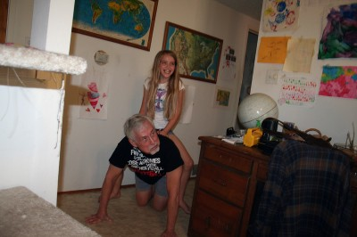 Amara riding on Grampy's back