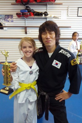Amara receives her yellow belt and trophy
