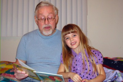 Amara and Grandpa reading together