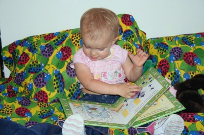 Amara reading in bed - 17 months old