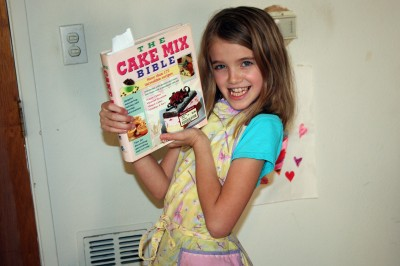 Amara holding the Cake Mix Bible