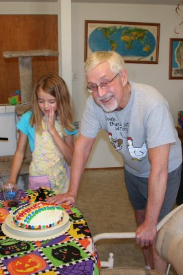 Amara showing Grampy her finished cake
