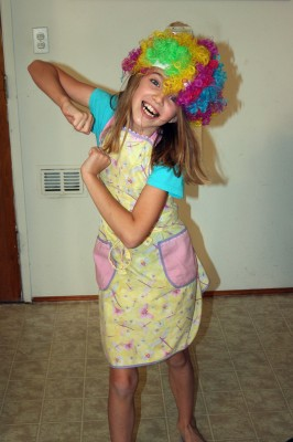 Amara dancing in her wig and her apron