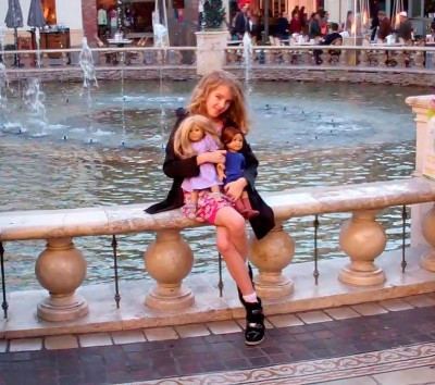 Amara and her dolls at the fountain at The Grove