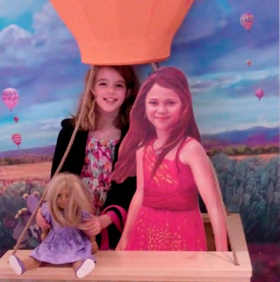Amara and Lily ride with Saige in her hot air balloon