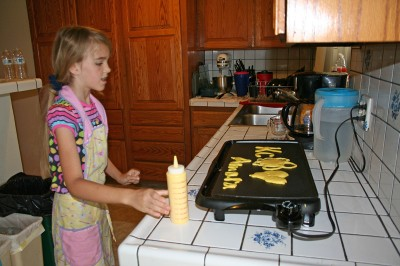 Amara Writing her Name in Pancakes