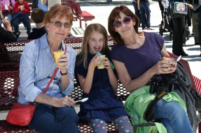 Grandma Judi, Amara and Grandma Kc having snow cones