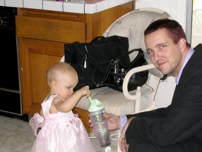 Daddy helps Amara get a drink
