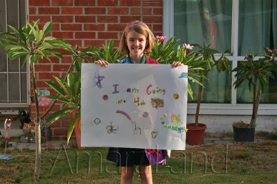 Amara holding her sign proclaiming 4th grade