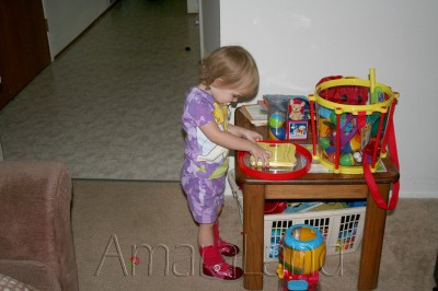 Amara and her toys July 2006