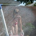 Amara loves her swing set but it is even more fun when you add water!