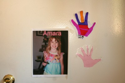 Amara's door with picture and handprints