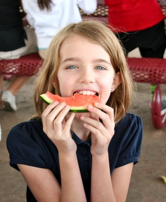 Amara eating watermelon at lunch