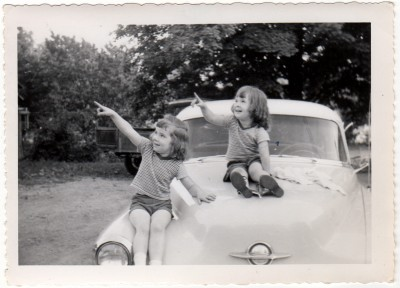 Kc and her sister sitting on the Oldsmobile