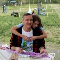 Amara hugging her Daddy while he tallies lap cards