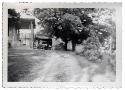 The Old Model-T sitting in the driveway in front of the barn