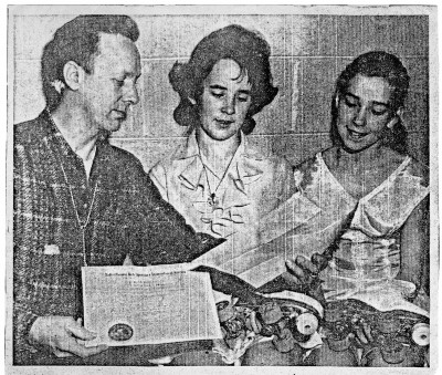 Newspaper clipping of Ernie our skating instructor with Judy and me.