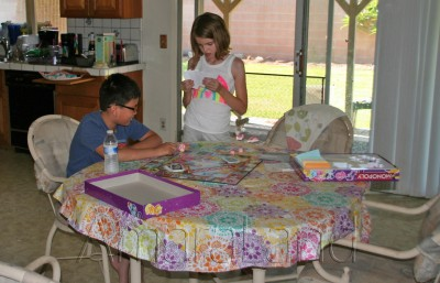 Amara and Fred playing My Little Pony Monopoly
