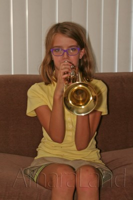 Amara playing her trumpet for Grandma and Grandpa