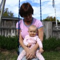 Amara on Grandma Kc's lap swinging October 8, 2004