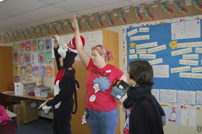 The Cat in the Hat with Thing 2 and Thing 1 in the classroom presenting books
