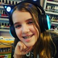 Amara in her cat headphones